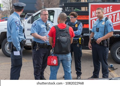 MINNEAPOLIS - May 1, 2018: A group of Minneapolis Police sergeants speak to a protest organizer before the International Workers' Day March.