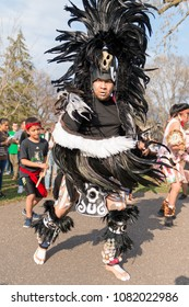 MINNEAPOLIS - May 1, 2018: An individual in Aztec dress dances after the International Workers' Day March, hosted by a number of community organizations and labor unions.