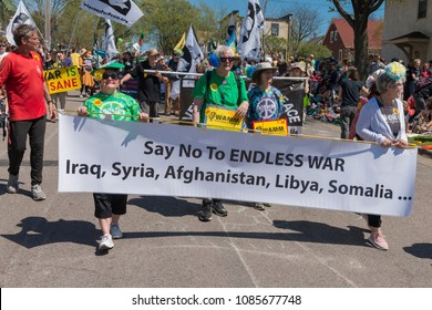 MINNEAPOLIS - May 6, 2018: Anti-war protesters march in Minneapolis' yearly May Day parade, organized by In the Heart of the Beast Puppet and Mask Theatre.