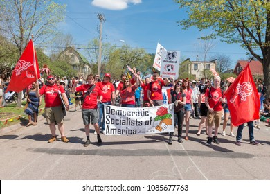 MINNEAPOLIS - May 6, 2018: The Democratic Socialists of America partake in Minneapolis' yearly May Day parade. Organized by In the Heart of the Beast Puppet and Mask Theatre, the parade, ceremony, and