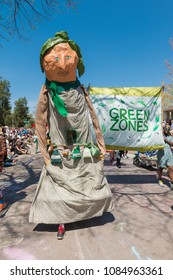 MINNEAPOLIS - May 6, 2018: A giant gardener appears in Minneapolis'?? yearly May Day parade, organized by In the Heart of the Beast Puppet and Mask Theatre.