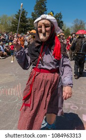 MINNEAPOLIS - May 6, 2018: An individual dressed to look like an elderly woman leads a band in Minneapolis's yearly May Day parade, organized by In the Heart of the Beast Puppet and Mask Theatre.