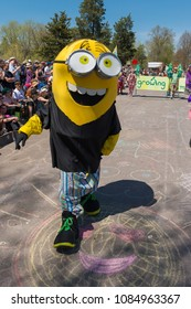MINNEAPOLIS - May 6, 2018: An individual dressed as a Minion from the Despicable Me movie series partakes in Minneapolis's yearly May Day parade.