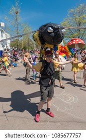 MINNEAPOLIS - May 6, 2018: An individual wears a giant bee puppet during Minneapolis' yearly May Day parade. Organized by In the Heart of the Beast Puppet and Mask Theatre.