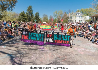MINNEAPOLIS - May 6, 2018: Individuals hold a banner leading Minneapolis' yearly May Day parade, organized by In the Heart of the Beast Puppet and Mask Theatre.