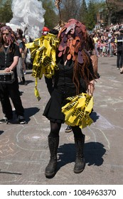 MINNEAPOLIS - May 6, 2018: An individual's costume represents rot and decay in Minneapolis' yearly May Day parade, organized by In the Heart of the Beast Puppet and Mask Theatre.