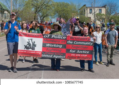 MINNEAPOLIS - May 6, 2018: Individuals proteting police brutality march in Minneapolis' yearly May Day parade, organized by In the Heart of the Beast Puppet and Mask Theatre.