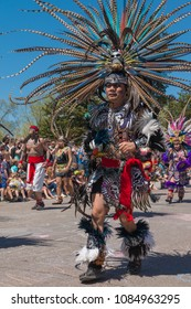 MINNEAPOLIS - May 6, 2018: A man in traditional Aztec dress dances in Minneapolis'  yearly May Day parade, organized by In the Heart of the Beast Puppet and Mask Theatre.