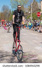 MINNEAPOLIS - May 6, 2018: A man rides a homemade double-decker bicycle in Minneapolis's yearly May Day parade, organized by In the Heart of the Beast Puppet and Mask Theatre.