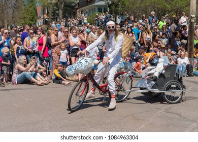 MINNEAPOLIS - May 6, 2018: A man has transformed his bicycle into a shiny unicorn for Minneapolis's yearly May Day parade, organized by In the Heart of the Beast Puppet and Mask Theatre.