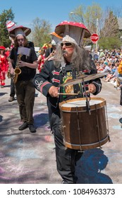 MINNEAPOLIS - May 6, 2018: A man dressed to resemble a mushroom marches in Minneapolis' yearly May Day parade, organized by In the Heart of the Beast Puppet and Mask Theatre.