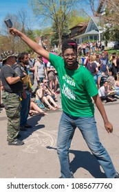 MINNEAPOLIS - May 6, 2018: A man encourages the crowd to chant with him during Minneapolis' yearly May Day parade. Organized by In the Heart of the Beast Puppet and Mask Theatre.