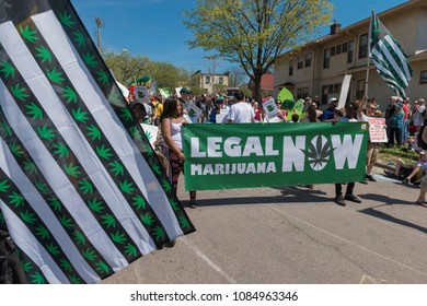 MINNEAPOLIS - May 6, 2018: People advocate for the legalization of marijuana in Minneapolis?? yearly May Day parade, organized by In the Heart of the Beast Puppet and Mask Theatre.