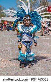 MINNEAPOLIS - May 6, 2018: An unidentified child in traditional Aztec dress smiles for the camera during Minneapolis  yearly May Day parade.