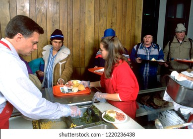 MINNEAPOLIS, MINNESOTA - DECEMBER 25, 1994: Man 34 served Christmas dinner by volunteers church soup kitchen.