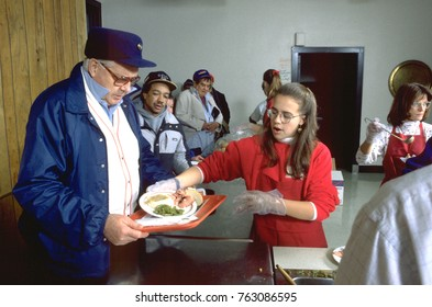MINNEAPOLIS, MINNESOTA - DECEMBER 25, 1994: Man 62 served Christmas dinner at church soup kitchen.