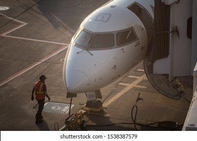 Minneapolis, Minnesota - September 19 2019: The nose of Delta Airlines Bombardier CRJ-900LR (Reg. N826SK) with aircraft technician on Minneapolis-St. Paul Airport (MSP)