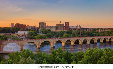 Minneapolis Minnesota at sunset on the Mississippi river,  beautiful stone arch bridge of Minneapolis,