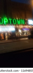 Minneapolis, Minnesota / USA - 07/03/2018: Hazy Vintage Neon Marquee for Uptown Shopping Center with Bikes