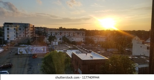 Minneapolis, Minnesota / USA - 07/04/2018: Orange Summer Sunset Over Uptown Minneapolis with Apartment Buildings and Rooftops