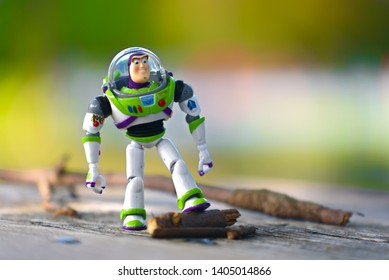 Minneapolis, Minnesota / USA - August 2, 2018: Buzz Lightyear stepping on a tree branch.