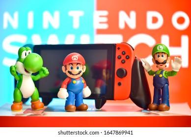 Minneapolis, Minnesota / USA - February 17, 2020: Mario, Luigi, and Yoshi on a Nintendo Switch background