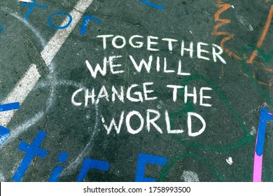 """MINNEAPOLIS, MINNESOTA / USA - JUNE 09, 2020: Admonition """"together we will change the world"""" statement on pavement at 38th and Chicago where George Floyd died."""