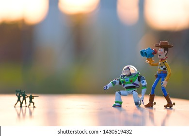 Minneapolis, Minnesota / USA - June 20, 2019: Woody and Buzz using binoculars to look for toy soldiers