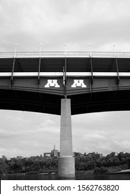 Minneapolis, Minnesota, USA - June 24, 2007: University of Minnesota logo on the   pedestrian bridge over the Mississippi River (black and white)