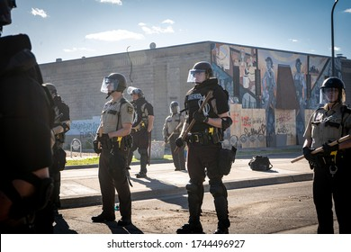 Minneapolis, Minnesota / USA - May 29 2020: state patrol police officers standing guard towards minneapolis riots and controlling demonstrators and protestors for George Floyd