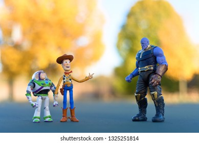 Minneapolis, Minnesota / USA - October 21, 2018: Woody, Buzz and Thanos with Autumn color background.