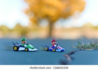 Minneapolis, Minnesota / USA - October 21, 2018: Mario Kart racing with Mario and Luigi.