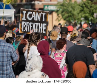 Minneapolis, Minnesota/United States of America - May 28, 2020: A group of protestors hold signs as they gather together to protest the police surrounding the death of George Floyd.