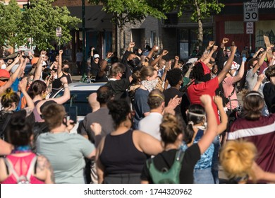 Minneapolis, Minnesota/United States of America - May 28, 2020: A group of protestors raise their hands in support of George Floyd as the protest the Minneapolis Police Department.
