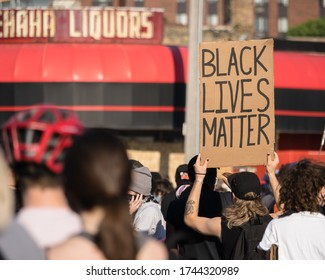 "Minneapolis, Minnesota/United States of America - May 28, 2020: A protester holds up a ""Black Lives Matter"" sign at a protest over the death of George Floyd."