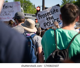 Minneapolis, Minnesota/United States of America - May 30, 2020: Protestors raise signs outside of the Fifth Police Precinct in Minneapolis in response to the death of George Floyd.