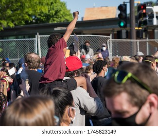 Minneapolis, Minnesota/United States of America - May 30, 2020: A young boy raises his hand in protest outside of the Fifth Police Police in response to the death of George Floyd.