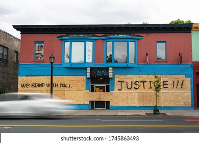 Minneapolis, Minnesota/United States of America - May 29, 2020: Buildings are boarded up in anticipation of another night of riots in Minneapolis in response to the death of George Floyd.