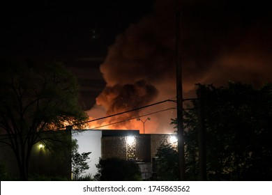 Minneapolis, Minnesota/United States of America - May 29, 2020: Flames are visible in the distance as a building burns during the riots surrounding the death of George Floyd.