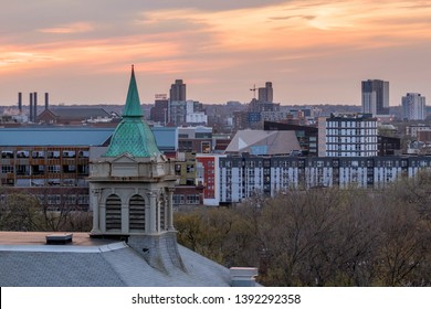 MINNEAPOLIS, MN - APRIL 2019 - A Cityscape Detail Shot Zoomed in on the University of Minnesota Campus and Northeast Minneapolis Neighborhoods at Sunset