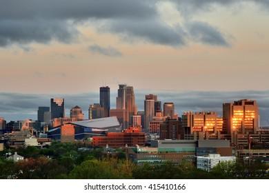 MINNEAPOLIS, MN - APRIL 22 2016: Downtown Minneapolis Skyline with Minnesota Vikings US Bank Stadium and the University of Minnesota