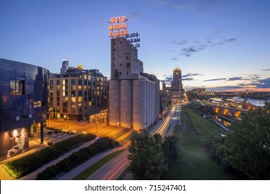 MINNEAPOLIS, MN - AUGUST 2017 - A Wide Shot of Downtown, the Gold Medal Flour Mill, and Parts of the Hennepin and Stone Arch Bridges over the Mississippi at Twilight