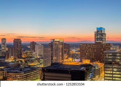 MINNEAPOLIS, MN - FALL 2018 - A High Angle Shot of Downtown Minneapolis Loring Park Skyline Illuminating during Twilight