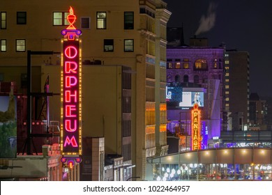 MINNEAPOLIS, MN - FEBRUARY 2018 - A Telephoto Night Shot Looking Down Downtown Minneapolis' Hennepin Avenue and Theater District on the Orpheum and the Pantages Neon Signs