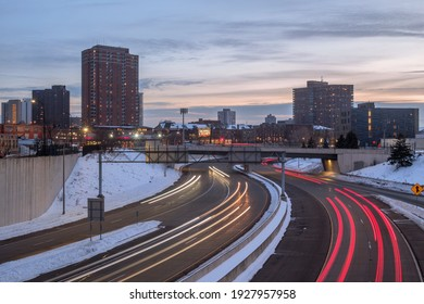 MINNEAPOLIS, MN - JANUARY 2021 - A Winter Sunset Shot of High Rise Apartment Buildings over Highway 394 in Downtown Minneapolis