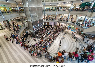 """MINNEAPOLIS, MN - JULY 28:  Mall of America stage circle, on July 18, 2013, in Minneapolis Minnesota. People gather on several levels and stand in lines for the authors of the book """"Mortal Instrument"""""""