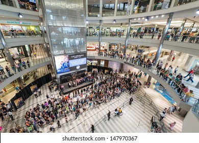 "MINNEAPOLIS, MN - JULY 28:  Mall of America stage circle, on July 18, 2013, in Minneapolis Minnesota. People gather on several levels and stand in lines for the authors of the book ""Mortal Instrument"""