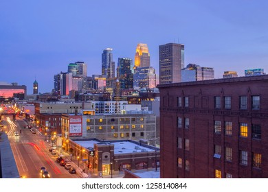 MINNEAPOLIS, MN - MARCH 2018 - A Wide Angle Shot of Downtown Minneapolis Reflecting Pink Dusk Light as North Loop Traffic Passes in the Foreground