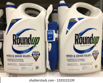 Minneapolis, MN - March 8, 2019: Retailer store shelf with containers of RoundUp weed killer. This product was recently linked to cause cancer (Non-Hodgkin Lymphoma) and is currently under litigation