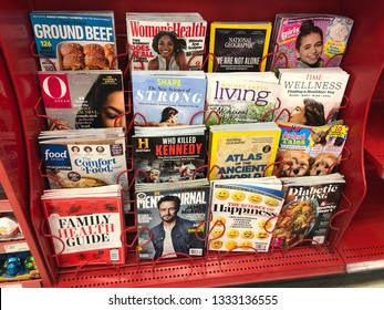 Minneapolis, MN - March 8, 2019: Variety of magazines at a checkout aisle at a Target retail grocery store. These periodicals are typical impulse purchases from customers